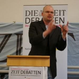 """""""Debattieren ist nicht nur Hobby, sondern Lebenseinstellung"""" - Tim Richter über Herausforderungen, Lösungen und Zukunftsmusik"""