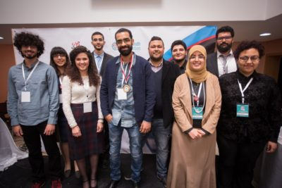 The top 10 speakers of the English track with Firas Mansouri in the middle. - © YAV